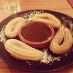Hot chocolate sauce with churros for dessert!