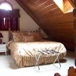 Upstairs Bedroom, complete with fireplace, tv & full bath