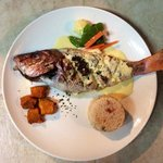 Whole baked Red Snapper with Ochro Rice and Lime Butter Sauce