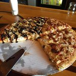 "16"" pizza, half w/Ham, bacon and pineapple and half w/ their feature of the day- bacon, black/gr"