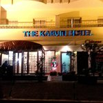 Enter in the Karvin Hotel.