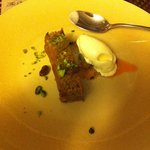 Carrot cake with cream cheese ice cream and pistachios