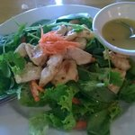 Salad with delightfully fresh green topped with chicken
