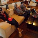 Pastor relaxing in foyer