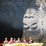 Under the maori carvings
