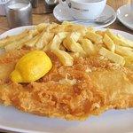 Crispy light batter on succulent fish with crisp and fluffy chips. Excellent.