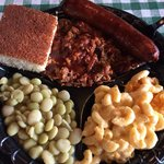 Pulled pork, smoke sausage, mac n cheese, baby Lima beans and corn bread.