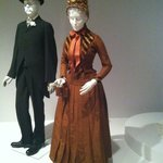 a couple of mannequins in beautiful old clothes