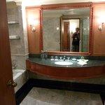 Large, well-lit bathroom.