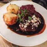 "Marinated beef ""Sauerbraten "" With raisins, sauce, red cabbage and potato dumplings"