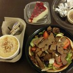 Cream of crab soup, Greek salad with gyro, and homemade cherry cheesecake