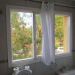 Large bathroom window with thin sheet curtain (No Privacy)