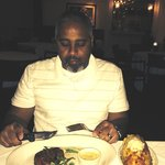 Enjoying his steak and potato