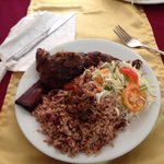 Jerk chicken at Antojito's with rice and beans, cabbage and tomato salad