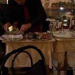 Antonio skillfully setting up family plates