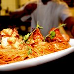King prawns on linguine nests.