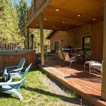 Homestead Lodge north deck with propane BBQ and hot tub.
