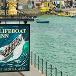 Lifeboat Inn sign on the harbour front in St Ives