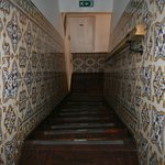 Traditional azulejo-decorated steep and creaky stairs