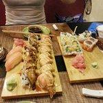 Dragon roll, salmon crunch roll, mango cucumber roll and spicy tuna