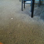 The floor in the resturant that the BOY walked and swept around at least 5 times.