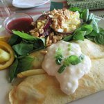 French crepes rolled with turkey and mushrooms; spinach and cashew salad with raspberry dressing