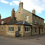 The pub sits on the corner of Peterborough Road and The Green