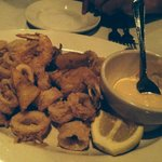 Frittura Mare - Lightly floured calamari, shrimp, and zucchini fried golden brown served with Pe