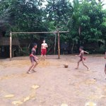My son playing soccer with village boys