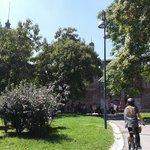 My sister biking behing Castello Sforzesco