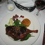 Roast duck, with pecan and raspberry sauce