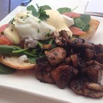 Eggs benedict with smoked salmon and a side of mushrooms