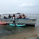 Locals pulled up to the dive boat (beached for bathroom break) selling crafts from their canoes.