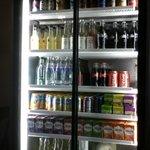 Drinks cabinet includes water, milk, pop and juice.