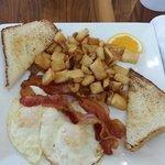 toast, potatoes, bacon, eggs