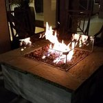 Fireplace in front of hotel bar