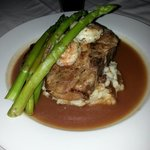 Surf and terf. Shrimp and asparagus over a huge perfectly prepared pork chop over mashed!