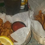 Fried Clams, gator and conch appitizer with Cajun fries