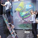 Street artists painting Croft Lane