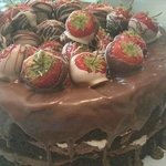 chocolate cake and chocolate dipped strawberrys