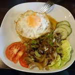 Fried rice with beef cube steak and fried egg.  Very good!