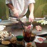 Teppanyaki chef preparing food