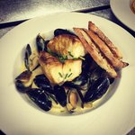 Curry and ginger dusted monk fish with mussels, leeks and apples in a saffron creamSauce.. Wow