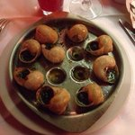 Try something French, the escargot are delicious