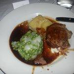 Slow roast shoulder of lamb with petit pois à la française