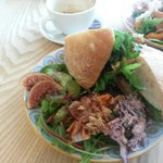 Falafel and hummus sandwich with tasty salad