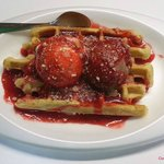 Waffle with Chocolate and Cream scoops, covered with our strawberry syrup!