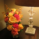 Beautiful floral arrangements add a sense of luxury to the room.