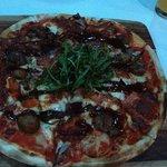 A pizza do bar é uma delicia