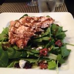 A magnificent Spinich salad. Topped with bacon, blue cheese crumbles, cranberries, & walnuts...